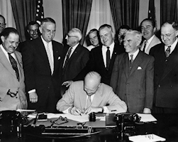 Eisenhower signs the bill